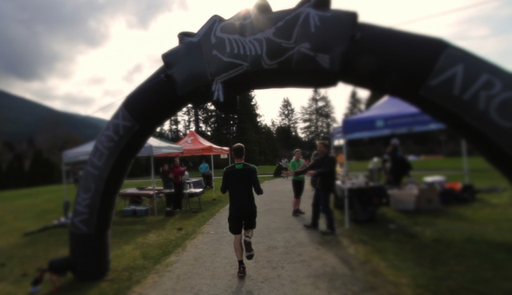 Karl crossing the finish line of Cap Crusher in Episode 1 of 'Running Vancouver'